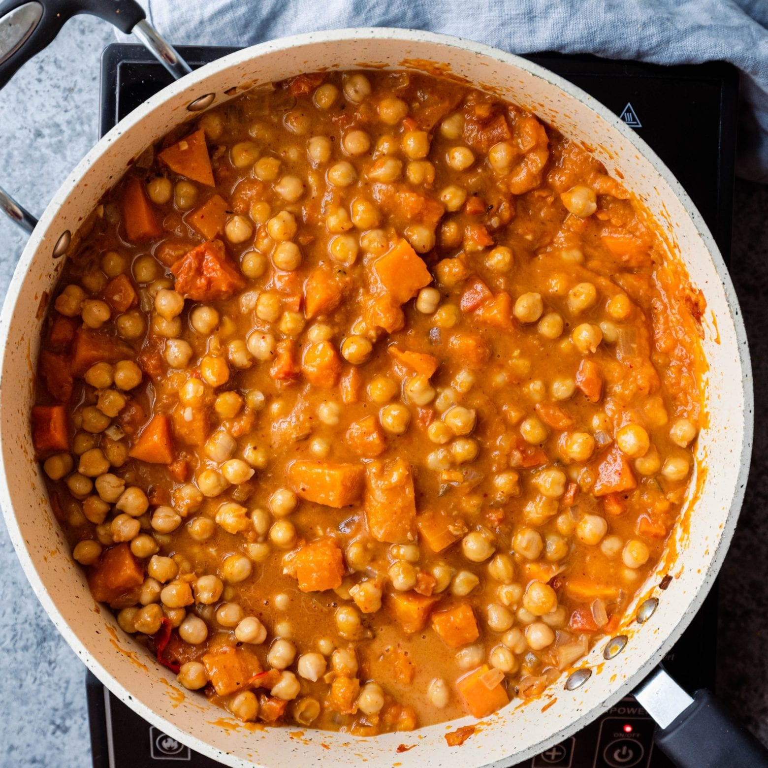 butternut squash curry with chickpeas in frying pan