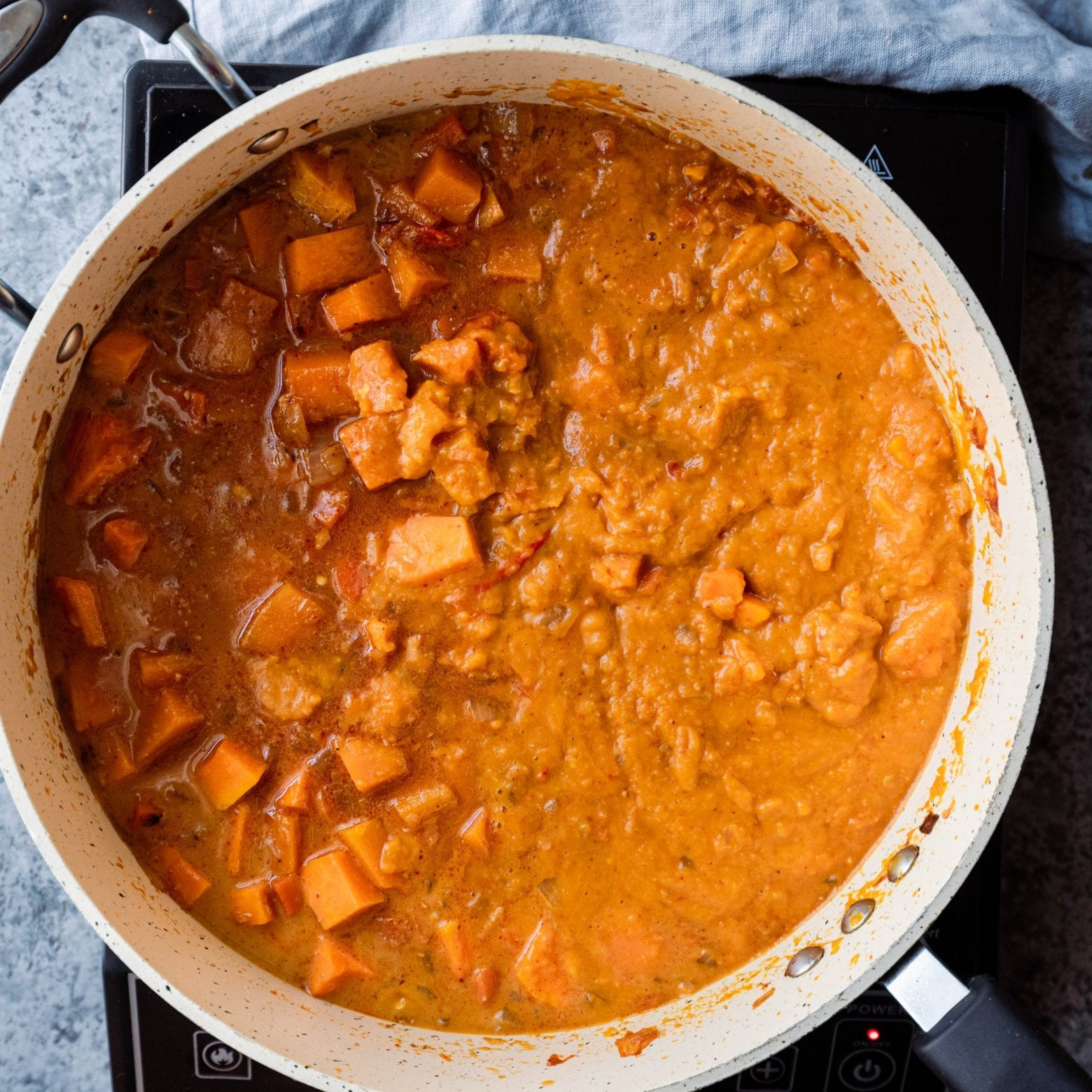 partially blended butternut squash curry in frying pan