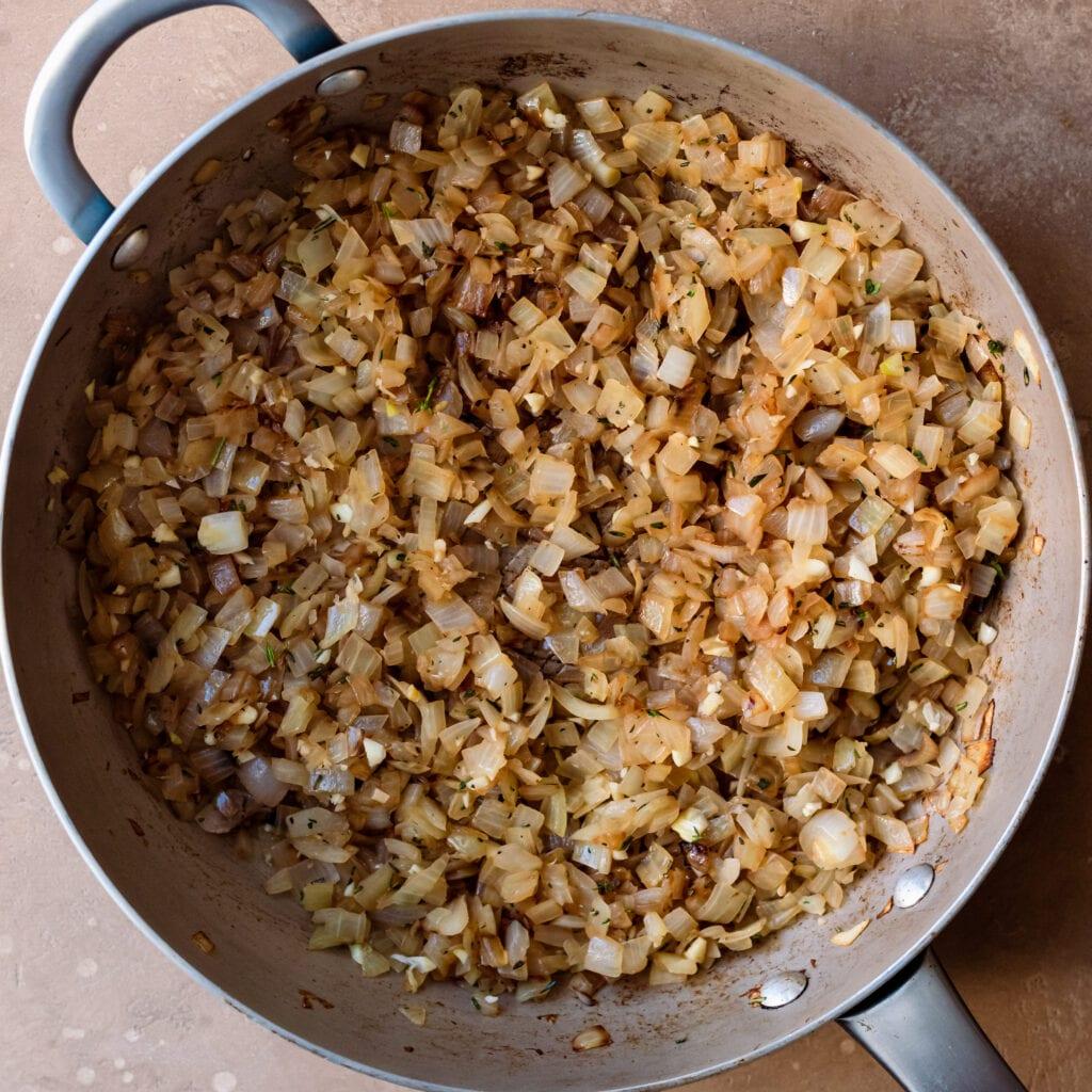 garlic, onions, herbs in saute pan