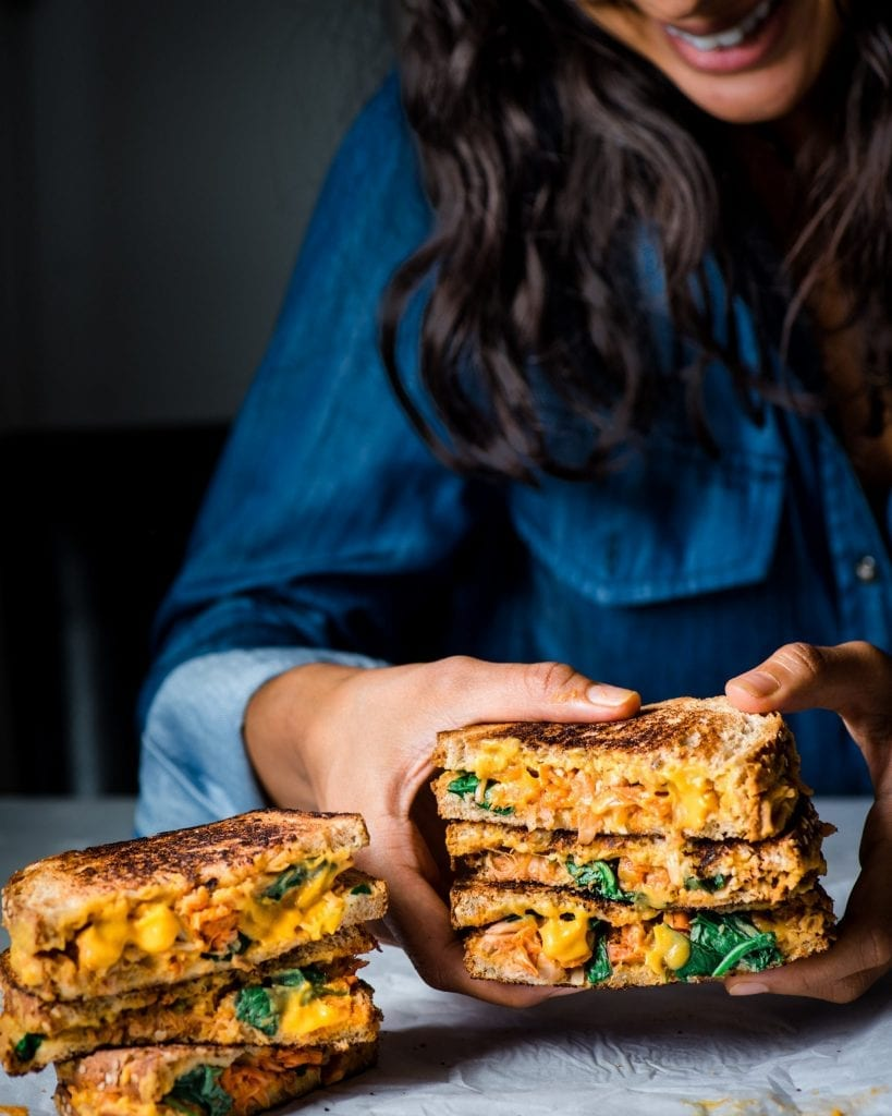 photo of woman holding vegan grilled cheese sandwich