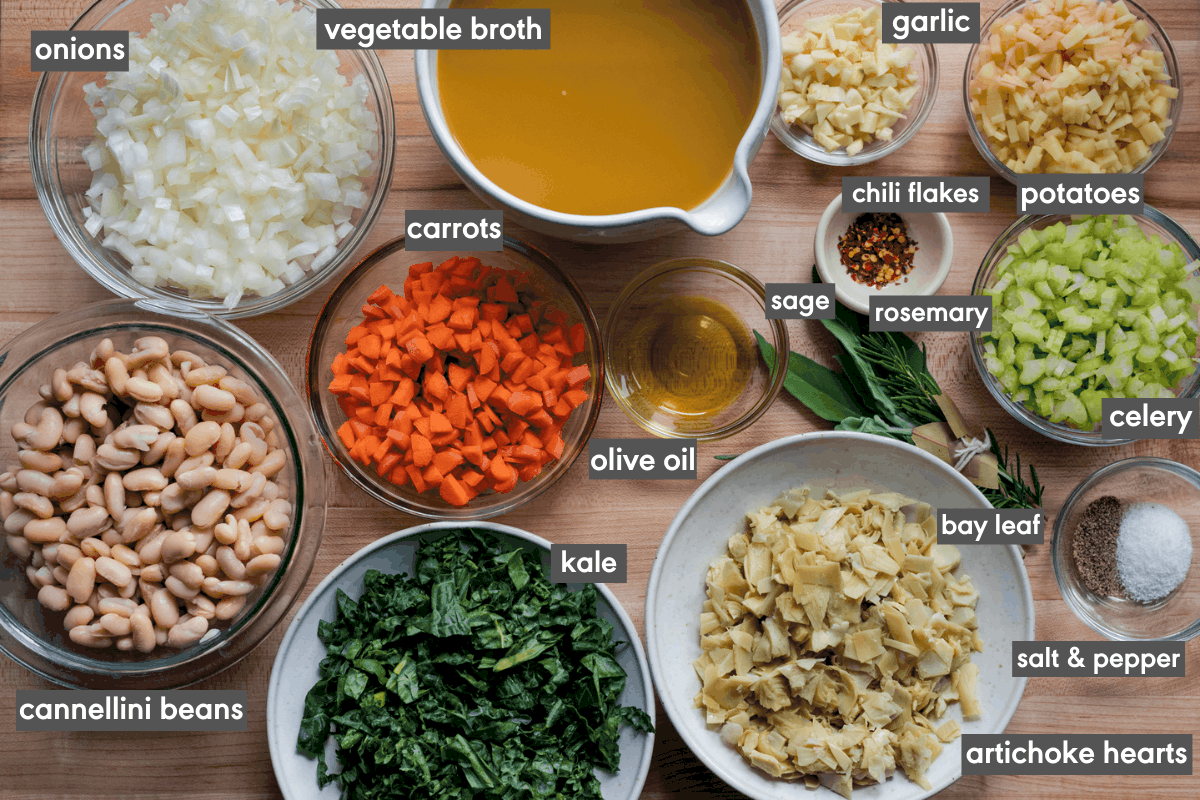 ingredients for white bean soup on cutting board with ingredients labeled
