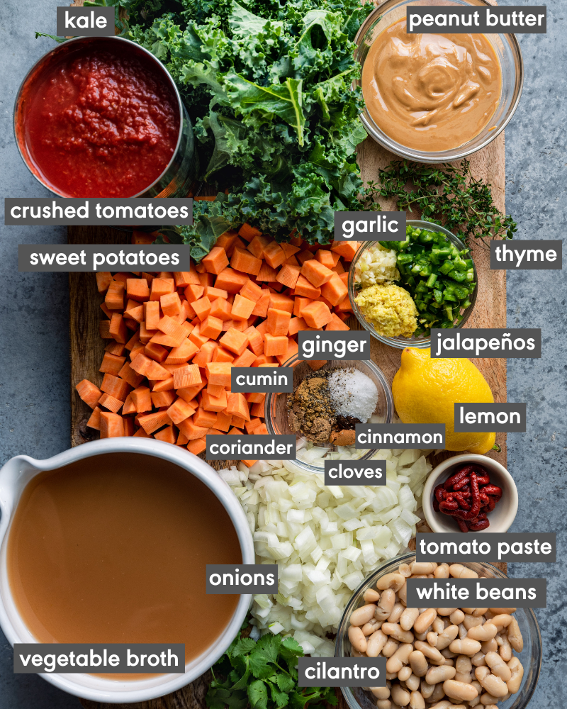 ingredients for west african peanut stew on a cutting board with ingredients written in text