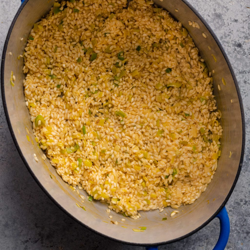 risotto being cooked in a dutch oven