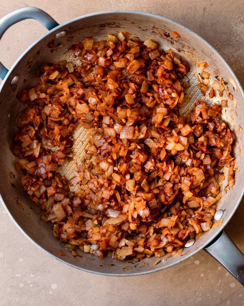 tomato paste stirred into onions in skillet