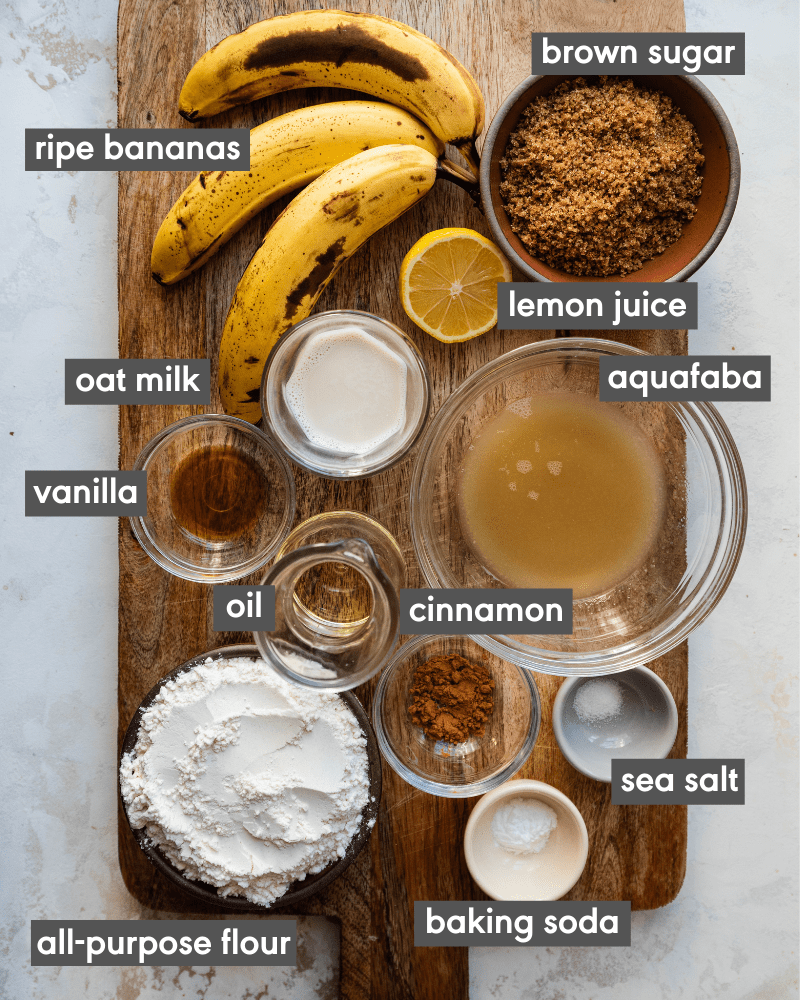 banana bread ingredients on wooden cutting board with written text of each ingredient