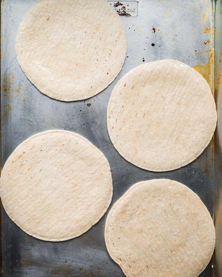 soft tortillas on baking tray
