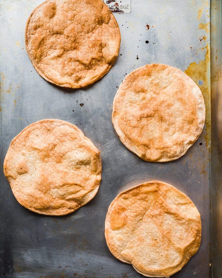 crispy baked tortillas on baking tray