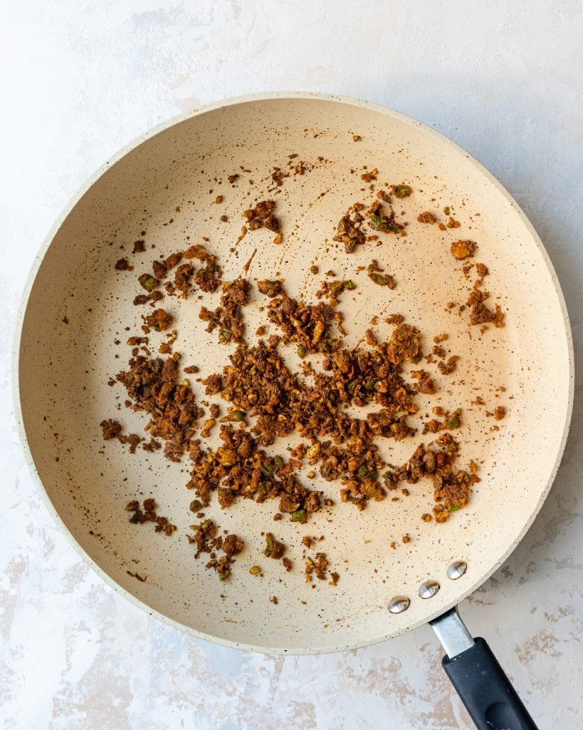 ground spices being sauteed in pan