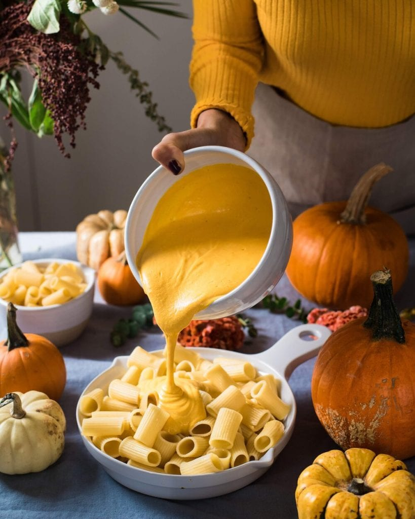 vegan mac and cheese sauce pouring over pasta