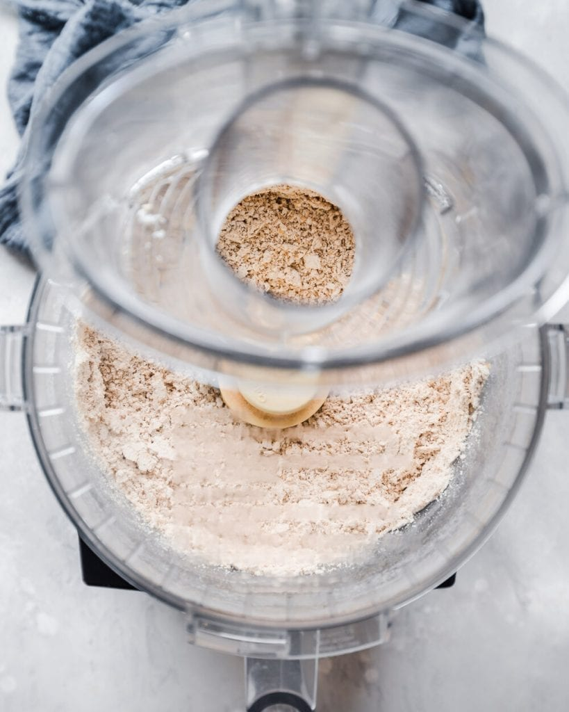 overhead shot of oats being being ground in food processor
