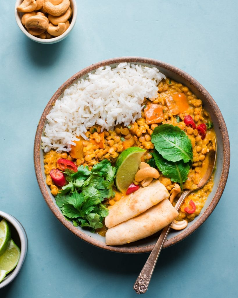 butternut squash lentil curry with Indian spices, cilantro, lime, and rice