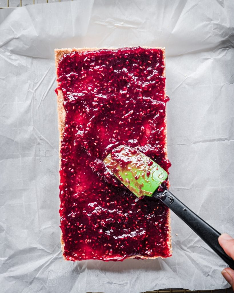 bars with jam being spread across