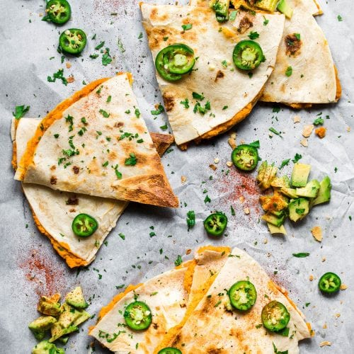 sweet potato quesadillas with jalapenos and avocado on butcher paper