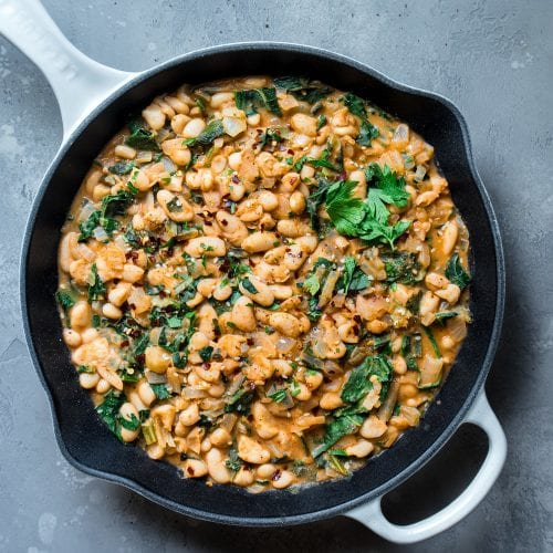 white beans and kale in skillet