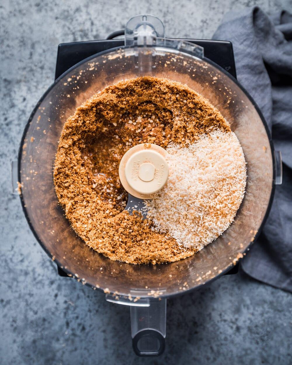 adding coconut oil and salt to food processor