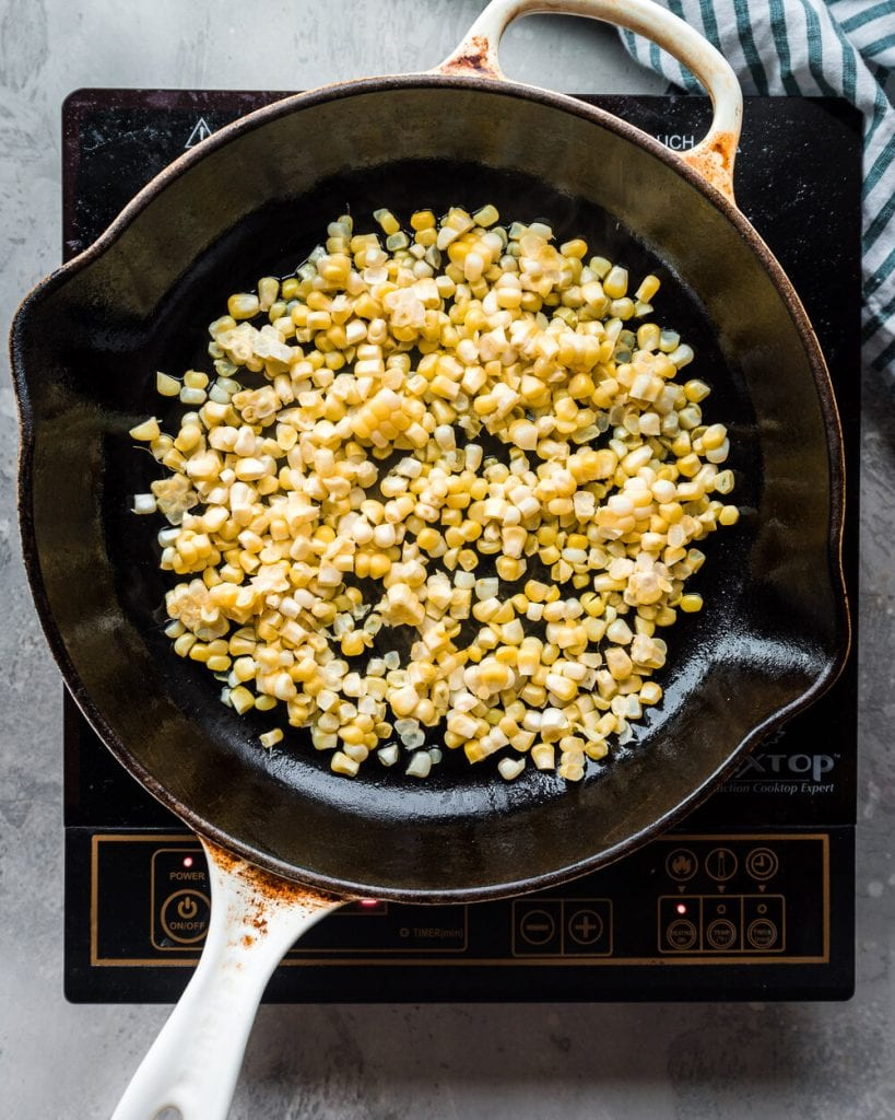 shaved corn in cast iron skiller
