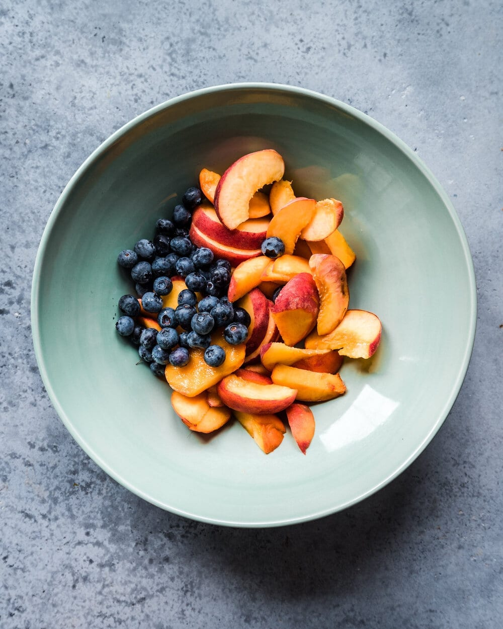 blueberries and sliced peaches in bowl