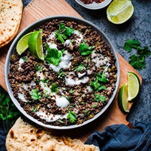 black beluga lentils with yogurt and cilantro in bowl
