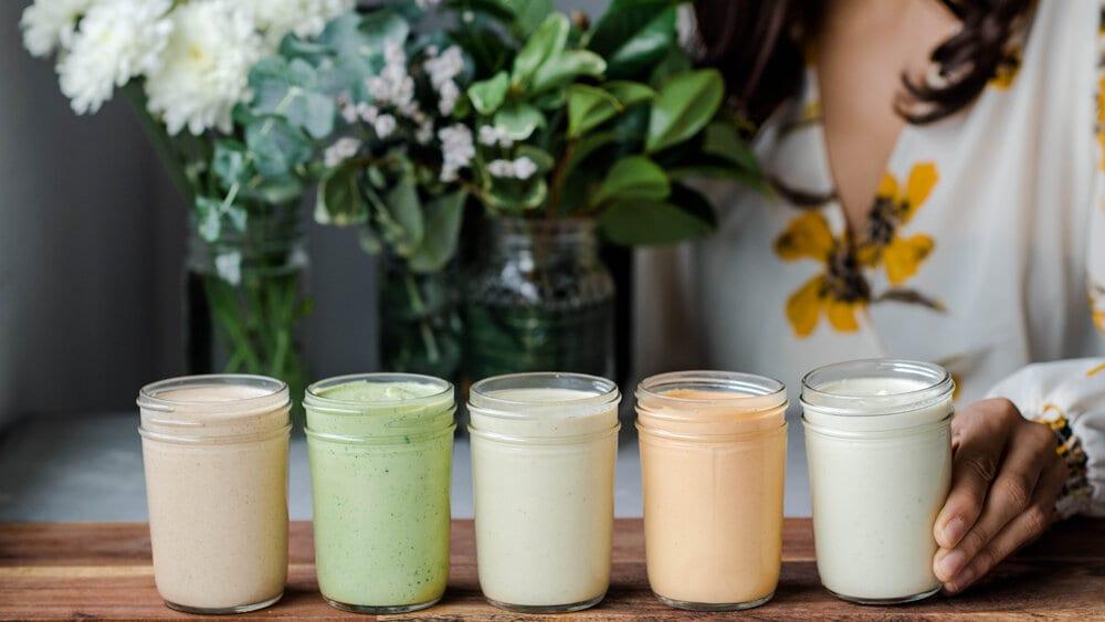 row of vegan cashew creams on cutting board