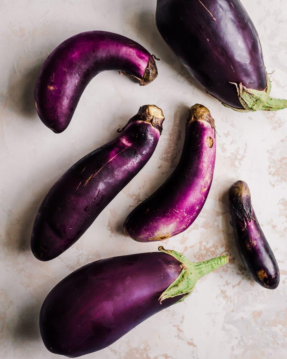 eggplant varieties on marble backdrop