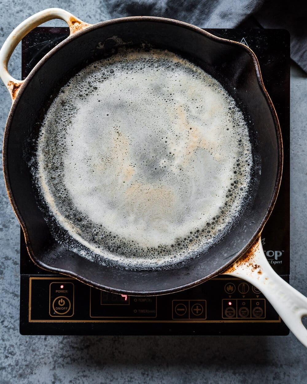 butter foaming in cast iron skillet