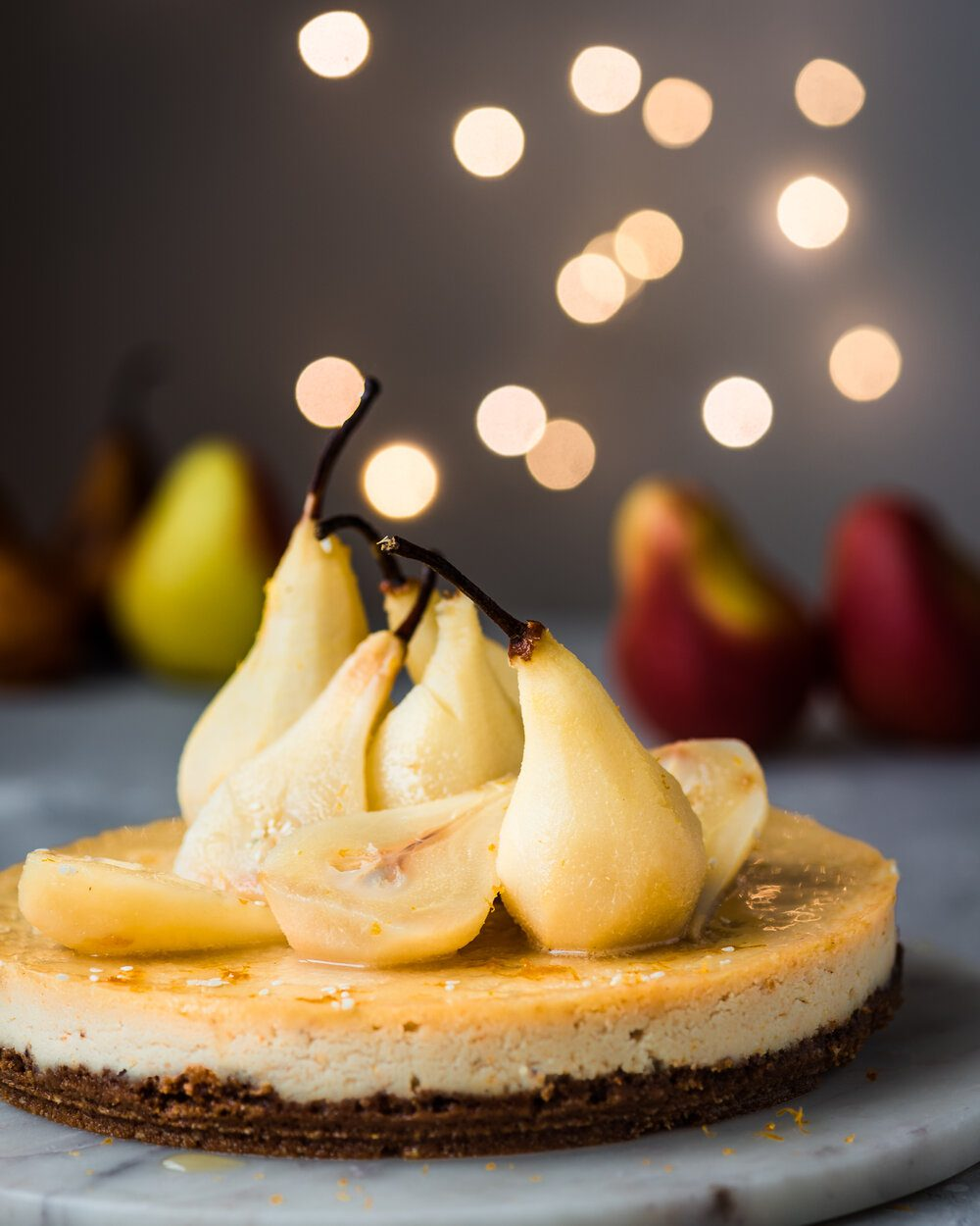 Ginger-Orange Baked Vegan Cheesecake with Poached Pears