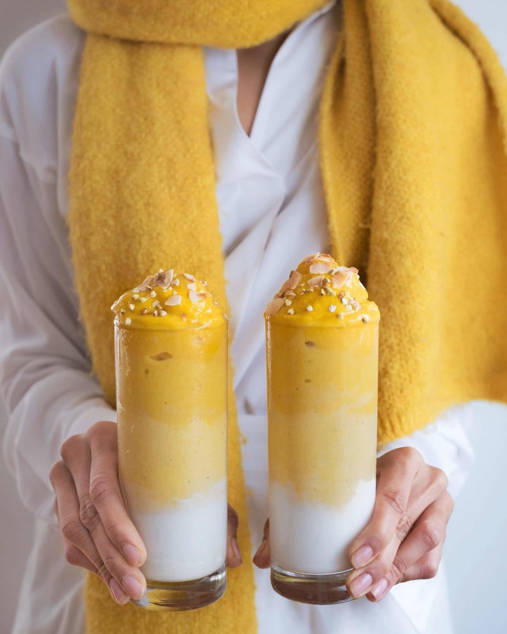 Layered ombreé smoothies: plant-based yogurt + mango smoothie (frozen mango, frozen zucchini, plant-based milk)