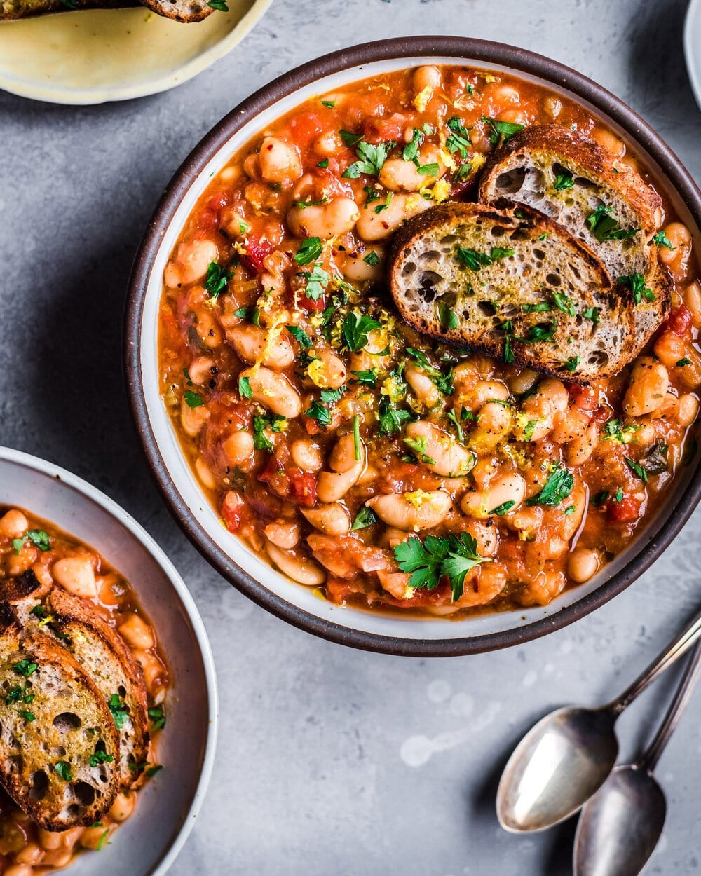 tomato white bean stew with parsley and bread