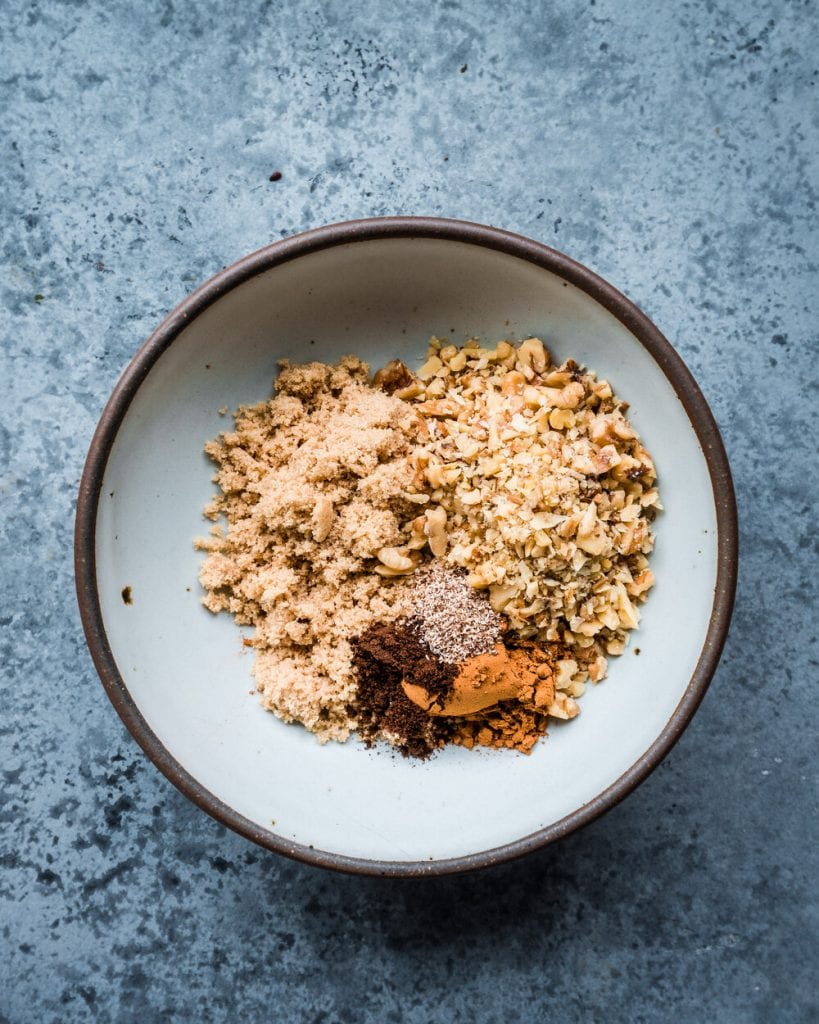 chopped walnuts with brown sugar, cinnamon, nutmeg, and cloves