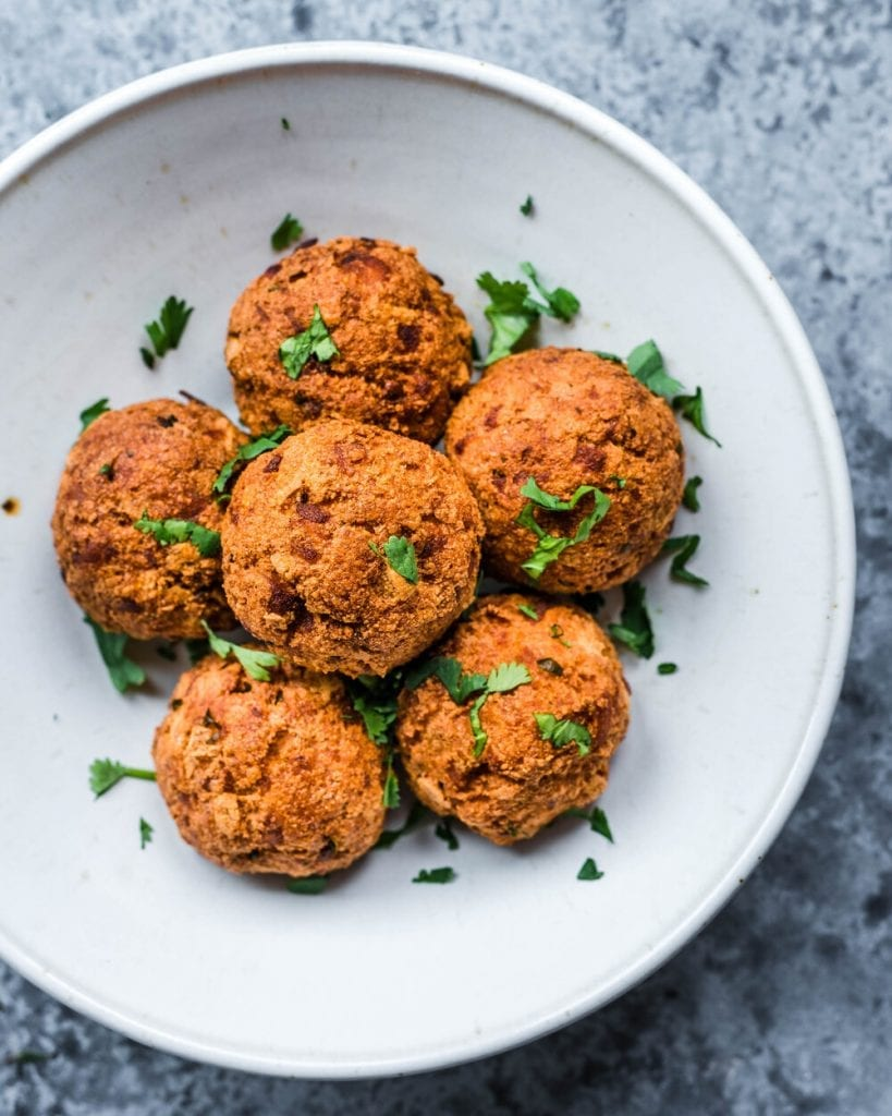 fried malai kofta balls in a white bowl