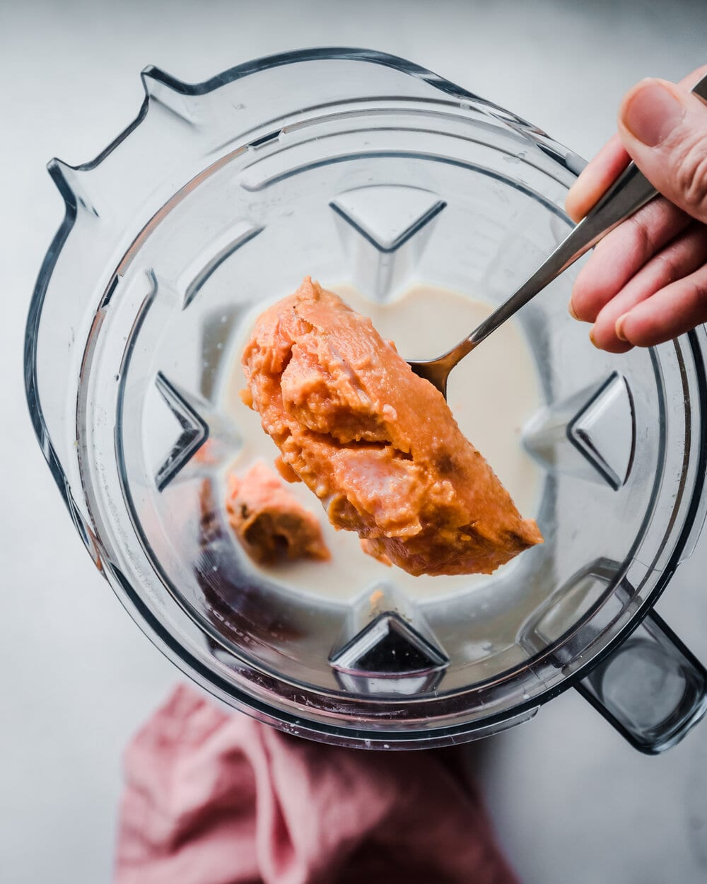 sweet potato being added to blender