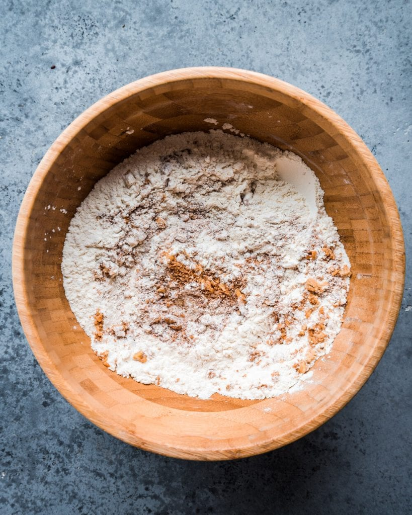 brown sugar and walnuts mixed with flour, baking powder, baking soda, and salt in bowl