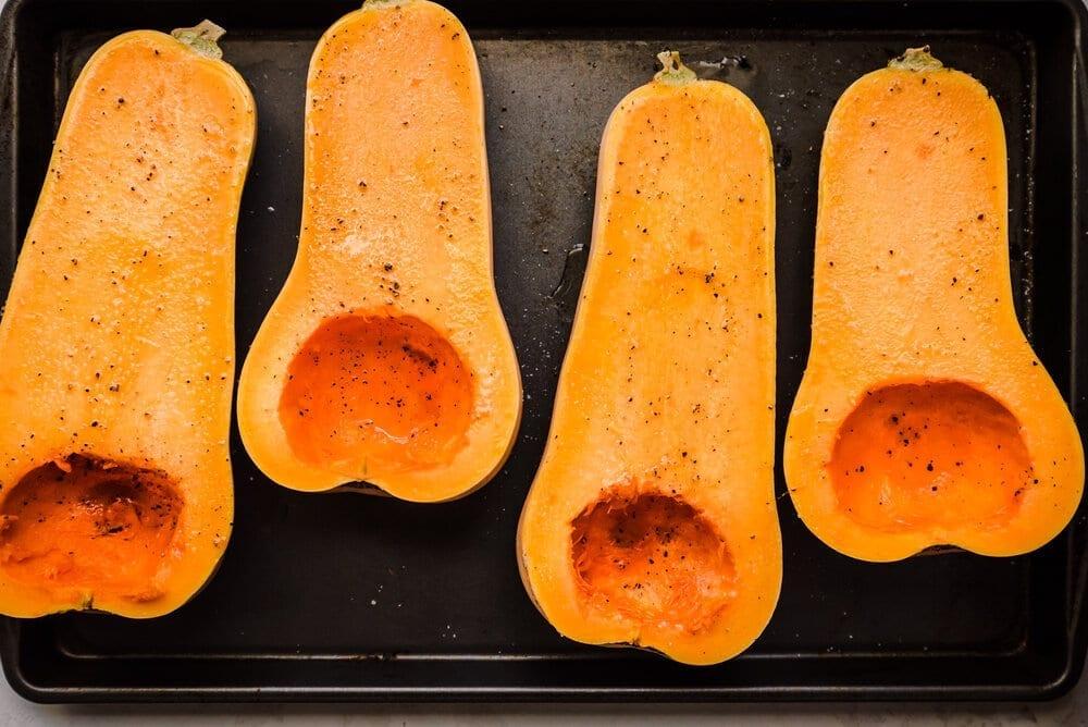 butternut squash halves oiled on baking sheet