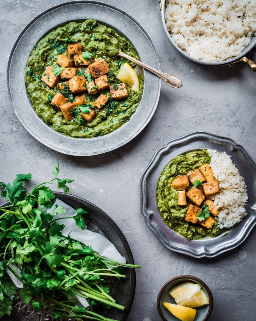 baked tofu palak paneer in a bowl with rice and other fixings