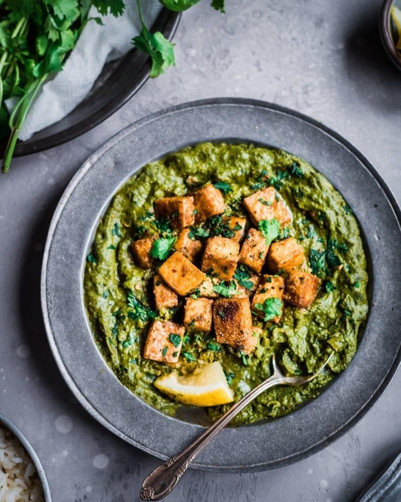 vegan palak paneer with crispy baked tofu on top