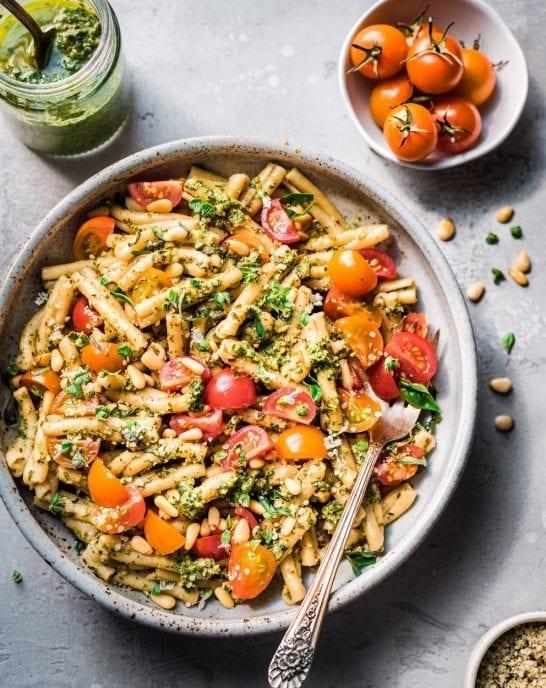 bowl of pesto pasta with tomatoes
