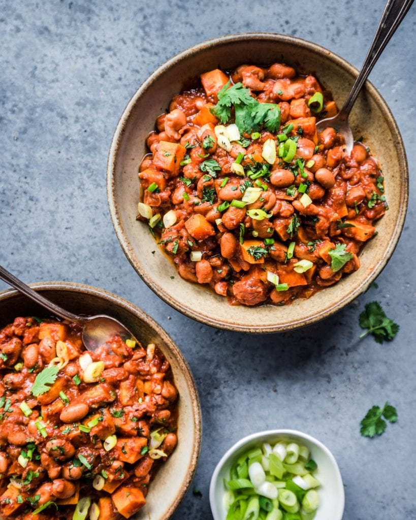 two bowls of vegan sweet potato bean chili