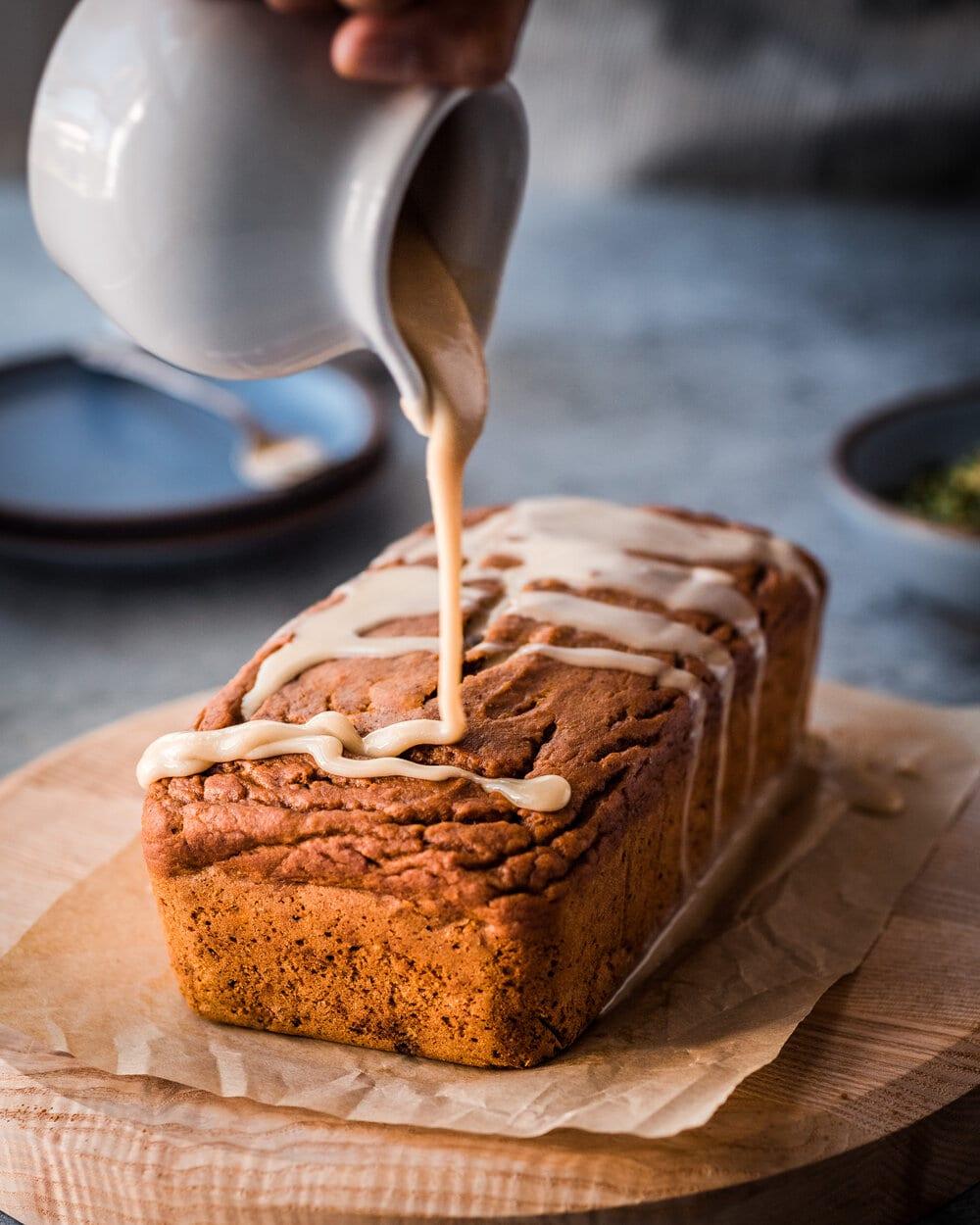 The Best Vegan Pumpkin Spice Bread. vegan pumpkin bread with maple tahini icing.