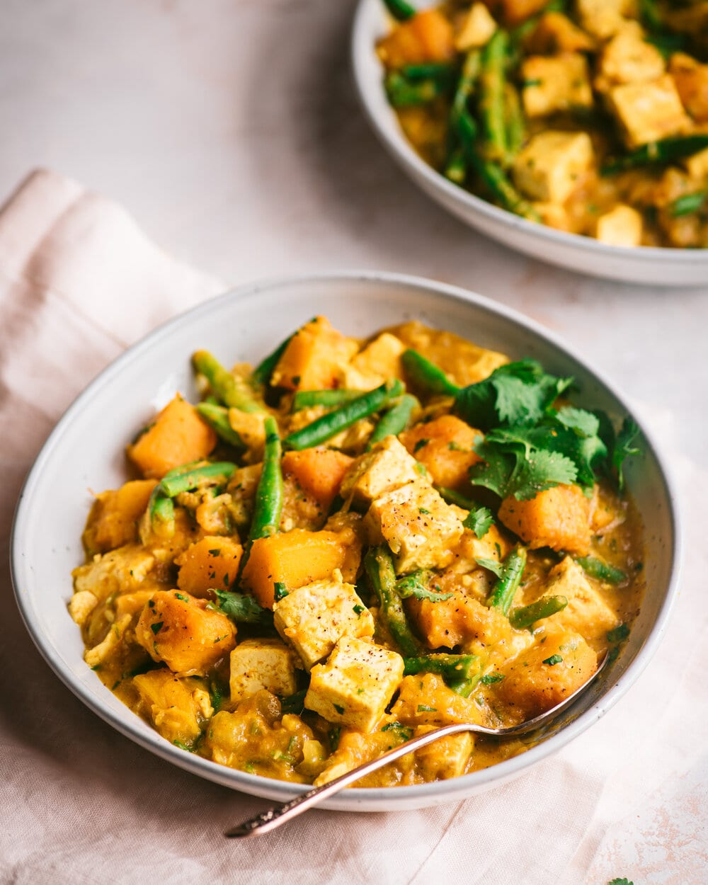 Vegan Pumpkin Curry with Tofu. Indian pumpkin curry with tofu, coconut milk, and green beans.
