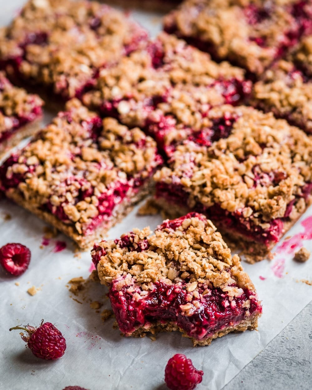 Vegan Raspberry Crumble Bars. vegan raspberry bars. crumble bars food photography.