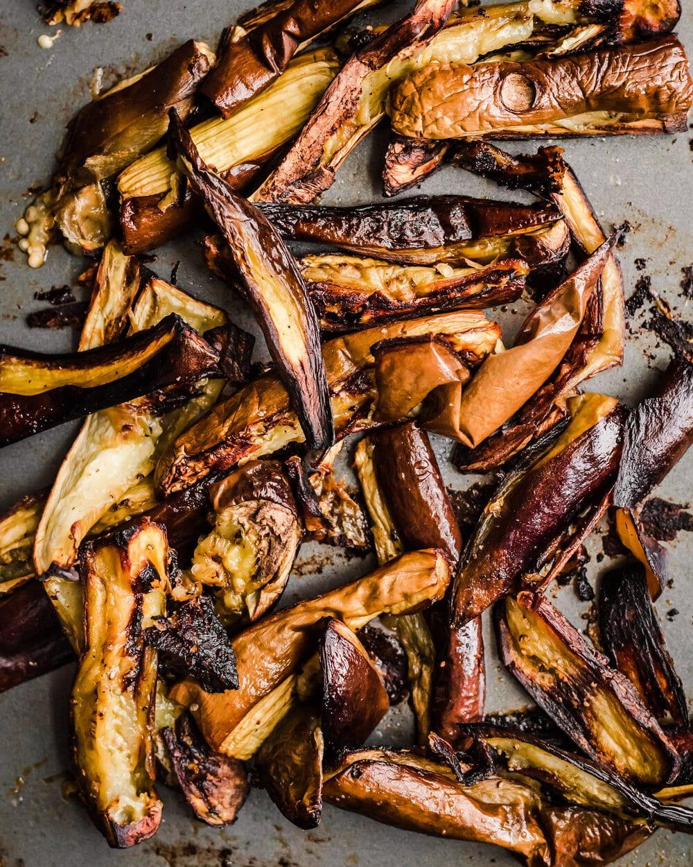 roasted eggplant on a baking sheet. eggplant food photography.