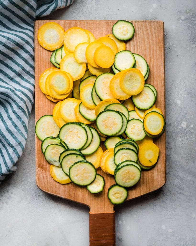 sliced zucchini on cutting board