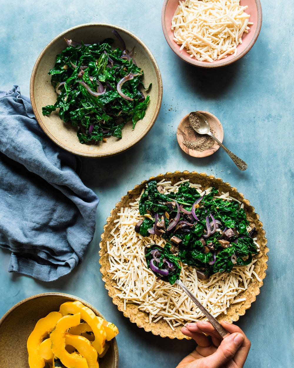 squash kale tart ingredients spooning kale (1 of 1).jpg