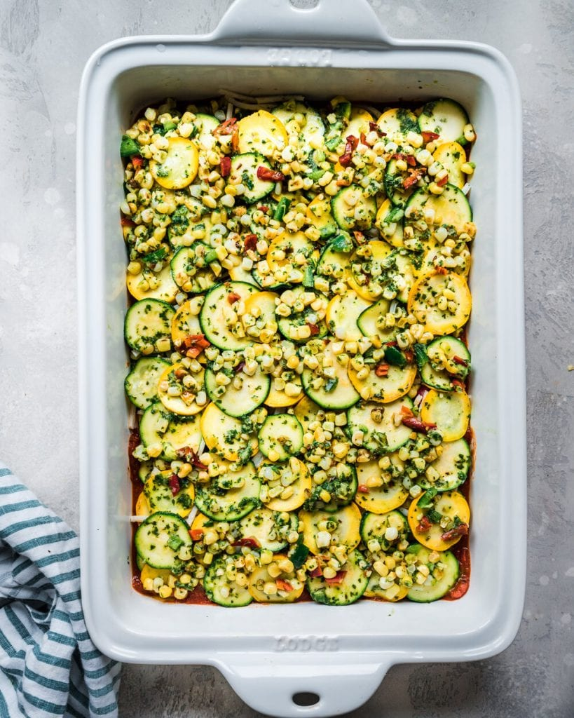 another layer of zucchini, corn, jalapeno, basil mixture in casserole pan