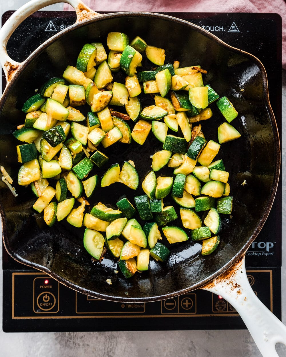 zucchini getting browned in a skillet