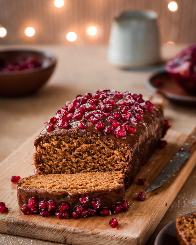 fluffy gingerbread cake with glaze and pomegranates