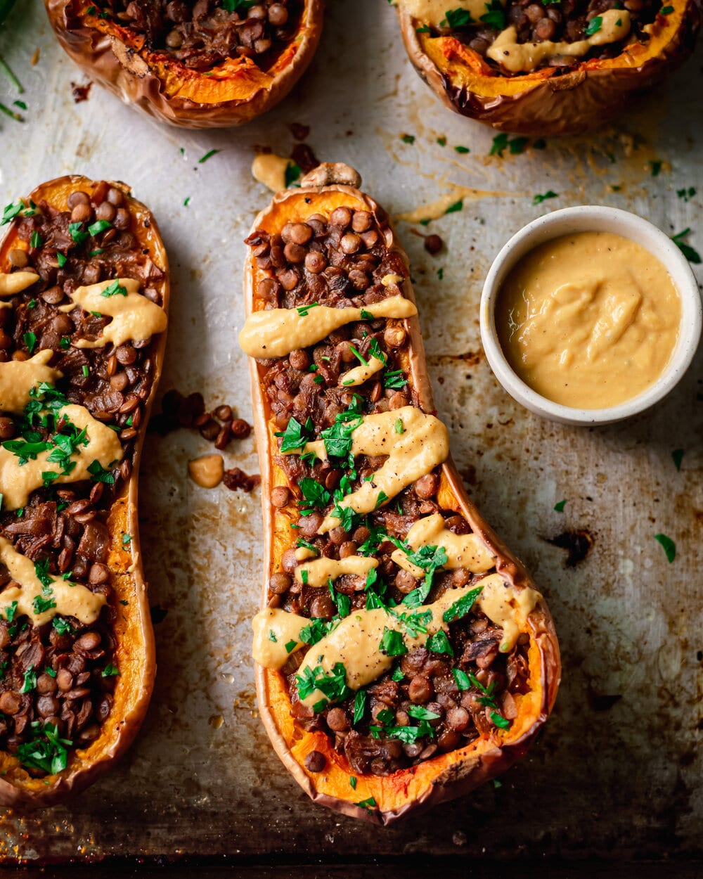 Vegan Sausage Stuffed Butternut Squash with creamy white sauce