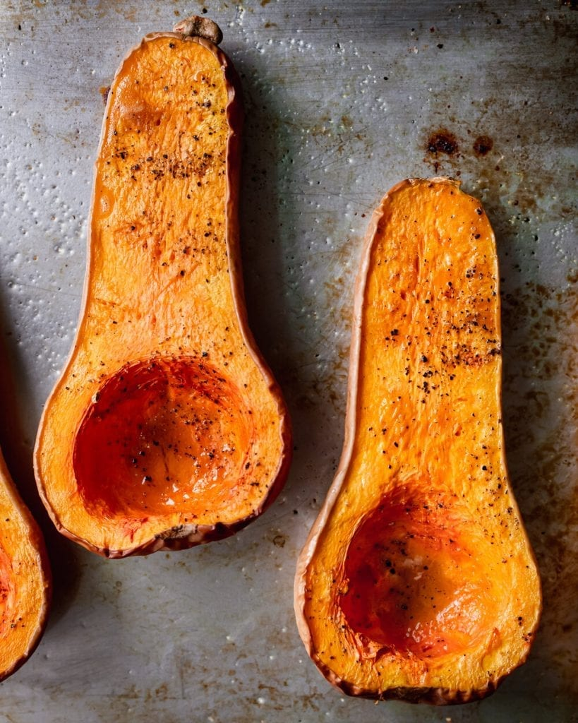 roasted butternut squash halves on baking tray