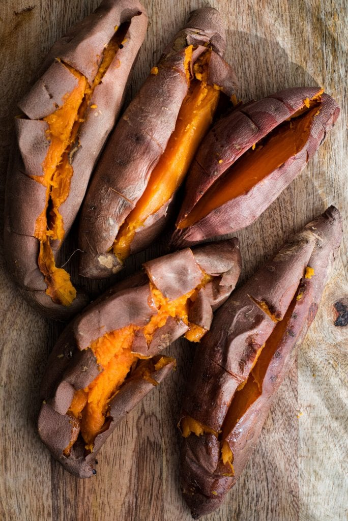 cooked sweet potatoes on cutting board