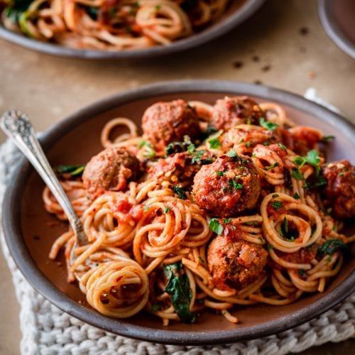 spaghetti and vegan meatballs on a plate